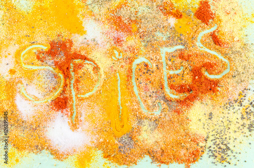Poster Word spices written in colorful seasoning background