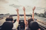 Friends having fun at car trip around the world.