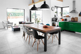 Modern dining room with dining table. - 126409811