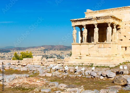 Foto op Plexiglas Cyprus Banner background with Acropolis, porch of caryatids, Erechtheum Temple in Athens, Greece and blue sky