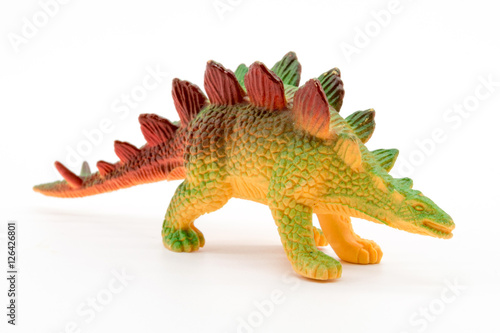 Stegosaurus toy model on white background Poster