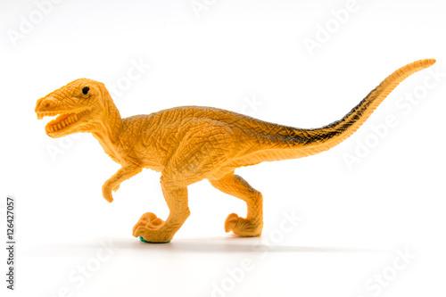 Poster Velociraptor toy model on white background