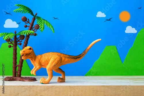 Poster Velociraptor toy model on wild models background