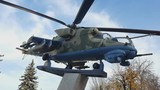 Russian helicopter Mi - 24 monument. Military combat transport helicopter in classic camouflage color