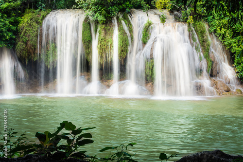 Fotobehang Olijf Sai Yok waterfall, the beautiful waterfall in forest at Sai Yok National Park - A beautiful waterfall on the River Kwai. Kanchanaburi, Thailand