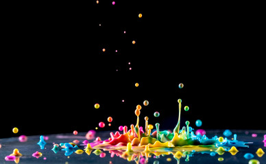 splashing color ink on black background