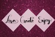 Live, create, enjoy, inspirational message on pink paper notes