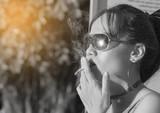 Young teen woman smoking cigarette