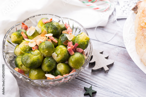 Papiers peints Bruxelles Brussels sprouts with fried bacon and almonds. Delicious Christmas themed dinner table. Holiday concept.