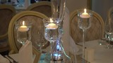 Candles Burn in Transparent Candlesticks