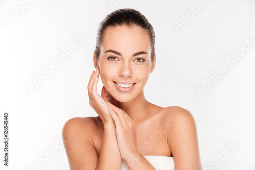 Tela Beauty portrait of a young woman with skin care posing