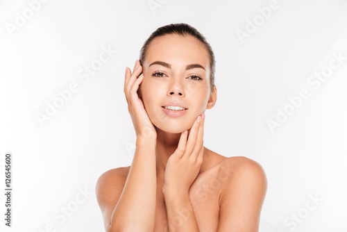 Poster Portrait of a woman with fresh skin looking at camera