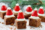 Santa Hat Brownie Bites with strawberries and whipped cream