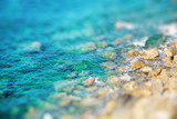 Rocky coast with clean blue see-through water. Miniature tilt shift lens effect.
