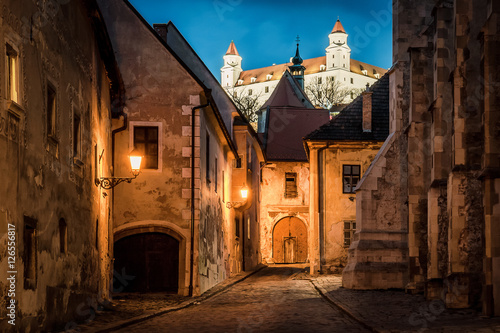 Lightened castle over night old town of Bratislava, Slovakia Poster