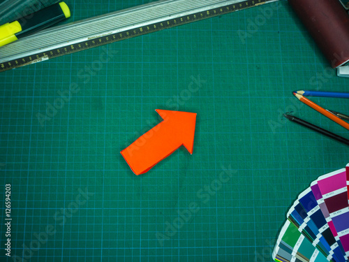 Poster Red Arrow on Cutting Mat
