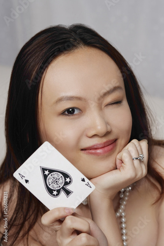 Poster Young woman holding ace of spades card