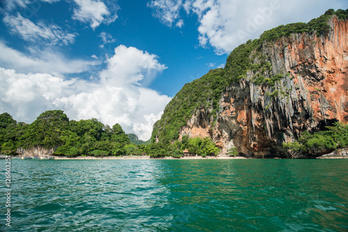 Poster Tropical landscape with rock islands, lonely boat and crystal cl