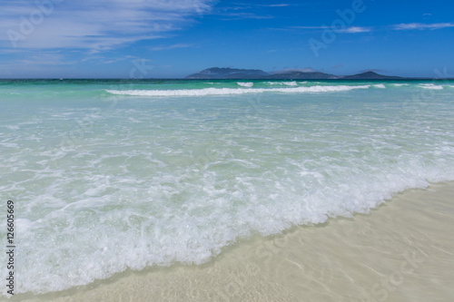 beach with blue and transparent water Poster