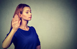 annoyed angry woman with bad attitude giving talk to hand gesture