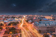 Aerial view of the capital city of Romania, Bucharest. Night sky with stars.