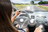Fototapety Self-driving car concept - woman driving modern car