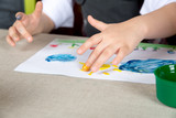 Child paiting the paint with your fingers