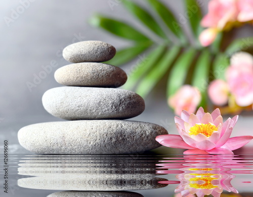Fotobehang Spa stones balance with flower lily on grey background