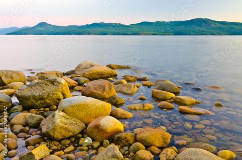 Foto op Aluminium Strand stony sea coast at the evening