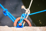 Dock ring trussed wrapped with mooring rope.