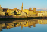 Florence, Italy - a cityscape reflection in Arno river at dusk