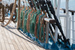 Deck and ropes, rigging on a wooden tall ship sail yacht. Close up view