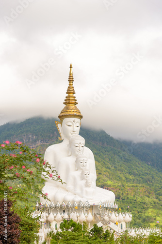 Juliste Five white Buddha image in Phetchabun, Thailand.