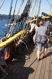 The crew sets the sails of the Lady Washington - 126786056