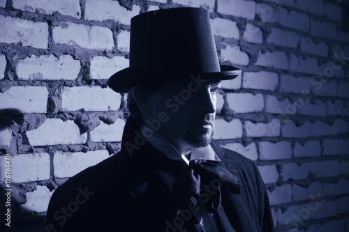 Victorian man in the black coat, top hat and in a tie Poster