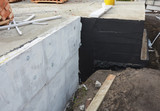 Waterproofing foundation bitumen and insulation with polystyrene foam boards for House Energy Saving. Damp proofing Coatings.Waterproofing house foundation with spray on tar. - 126805294