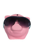 pink pig moneybox wearing sunglasses on a white background