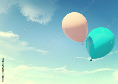 Colorful blue and pink balloons floating in summer holidays in pastel color filter, concept of summer, holidays, and joyful. Pastel blue and pink color also represent male and female - 126832833