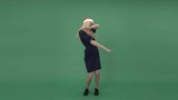 Young blonde woman in a dark blue dress showing off and hanging out, chroma key green screen