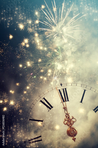 Abstract background with fireworks and clock close to midnight