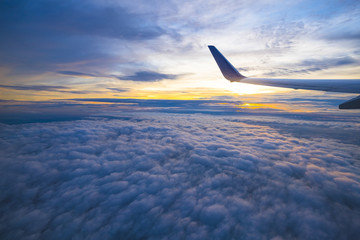 Beautiful view from window of airplane in sunrise sky