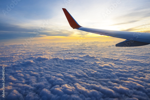 Sunrise and beautiful cloud view from window of aircraft - 126840263