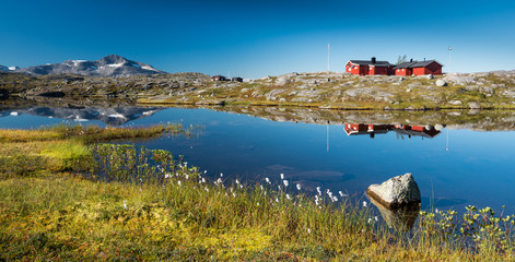 Typical Scandinavian Red Painted Cabins, Lapland © Markus