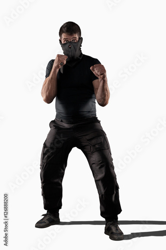 Poster Man with knife standing in prepared position isolated