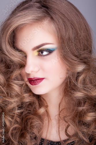 Plakát Beauty portrait of girl with red lips and colored make up