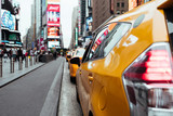 Taxi cabs on busy Time Square road