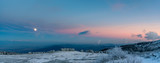 Amazing pink purple winter sunset in the mountains - beautiful frozen landscape - moon rising panorama