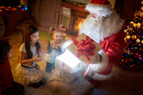 Surprised children with magical Christmas gift