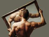 sexy muscular man with mirror