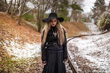 Woman walking on railway tracks